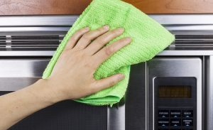 Cleaning Kitchen Appliance Fan Vents on Microwave Oven