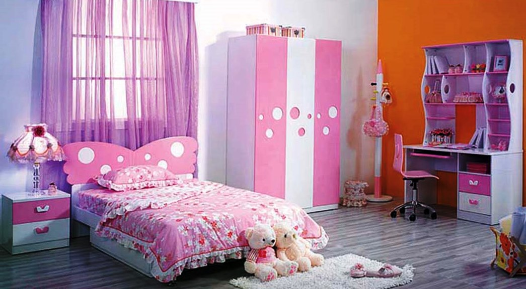 Ashley-Furniture-Kids-Bedroom-Sets-in-luxurious-pink-nuance-with-beautiful-table-lamp-also-purple-study-desk-and-cute-dots-wardrobe-comfy-flower-pattern-bedcover-also-furry-rug-transparent-curtains